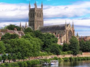 An image of Worcester Cathedral standing over the River Severn - one of the most popular attractions in Worcestershire
